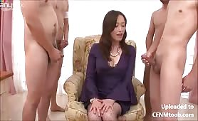 Asian milf surrounded by cocks