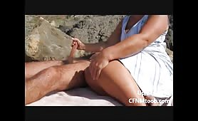 CFNM handjob at the beach