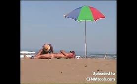 Beach CFNM MILF handjob