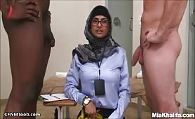 Arab Mia plays with mens cocks