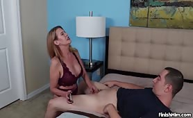 Mrs Evangeline jerks monster-sized cock