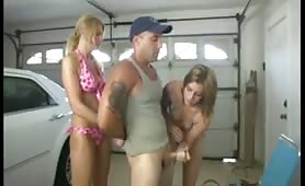 Jerked off in the garage by two babes